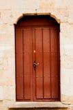 Nice door with wrought iron decoration Royalty Free Stock Photos
