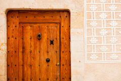 Nice door with wrought iron decoration Stock Photography