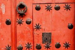 Nice door with wrought iron decoration Stock Photo