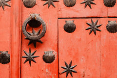 Nice door with wrought iron decoration Royalty Free Stock Photography