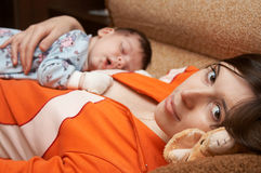 Nice Dream. Baby sleeps on her mother Royalty Free Stock Photos