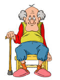 Nice elderly Grandpa is sitting on a small stool. Royalty Free Stock Images
