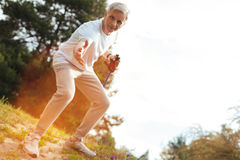 Nice elderly man stretching out his hand Royalty Free Stock Image