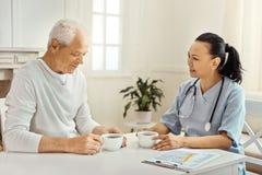 Nice elderly man telling his story Stock Image