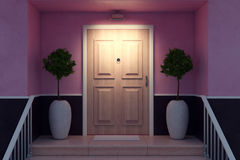 Nice entrance at night. Close up of nice entrance of a cozy house with decorative trees, railing and wooden door illuminated by lamp. 3D Rendering Stock Photos