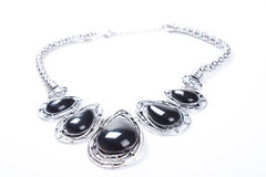A nice ethnic tracery metallic necklace isolated on white.  Stock Images