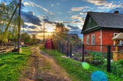 Nice Evening. Evening on a village. HDRi - compilation. The road to the sun Stock Image