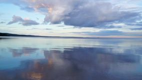 Nice evening lake and cloudy sky tilt stock video