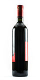 A nice exquisite bottle of wine on a white background.  Royalty Free Stock Photography