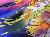Beautiful silk fabric with colorful flowers Royalty Free Stock Images