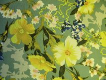 Beautiful silk fabric with yellow flowers Royalty Free Stock Image