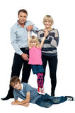 Nice family of a four having fun Royalty Free Stock Photography