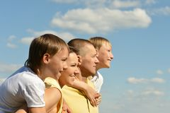 Nice family of four on sky Stock Images