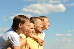 Nice family of four on sky Royalty Free Stock Photos