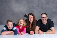 Nice family lying on the flor Royalty Free Stock Photo