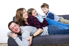 Nice family sit on the livingroom sofa Stock Photography