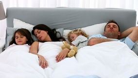 Nice family sleeping together Stock Images