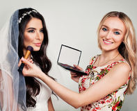 Nice Fashion Model Bride and Woman Makeup Artist Royalty Free Stock Image