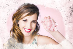 Nice female cleaner washing window with smile Royalty Free Stock Images