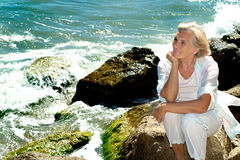 Nice female enjoying the sea breeze Stock Photos