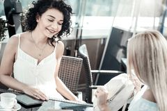 Nice female friends meeting at the cafe royalty free stock photo