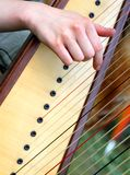 Nice female hand while plucking the strings of a harp 2 Stock Images