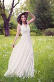Nice female model in white dress outdoors. Beautiful woman in gpring park royalty free stock photography