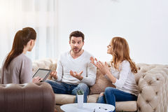 Nice female psychologist listening to her patients stock photos