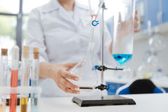 Nice female scientist holding a flask royalty free stock photo
