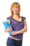 Nice female student holding book, smiling and looking at camera. Stock Photos