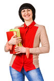 Nice female student holding book, smiling and looking at camera. Royalty Free Stock Photos