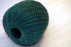 Nice fine merino yarn in teal color. Teal Merino Fine Yarn Macro Royalty Free Stock Photo