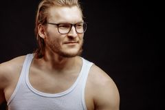 Nice fitness man wearing glasses. Looking aside Royalty Free Stock Images