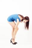 Nice flirtatious girl bending her body stock photography