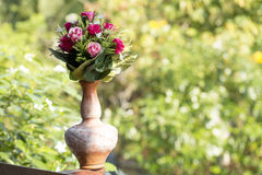 Nice flowers in the antique vase pot Stock Photography
