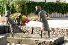 Nice fountain with statues of three young girls in the town of Fussen in Bavaria (Germany) Stock Photography