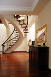 Nice foyer with interior stairs stock image