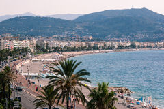 Nice, France. Image showing the Promenade des Anglais from the West End. A normal day at the beach in Nice, France Royalty Free Stock Images