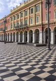 The famous place Massena in Nice. NICE, FRANCE - APRIL 23 2017: the famous place Massena in Nice, france, with its chess flooring royalty free stock photos