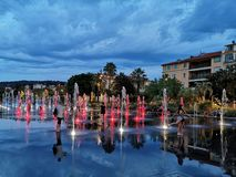 NICE, FRANCE - AUGUST 16, 2018: Dancing fountains in Promenade d. U Paillon in the evening in Nice, French Riviera royalty free stock image