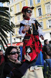 Nice, France, Carnival Children. Nice, France, Public Events, Carnival Parade, Mother with Daughter in Pirate Costume, Watching Parade in Crowd Royalty Free Stock Photo