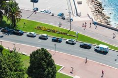 Nice, France - 16.09.16: cars are driving along the promenade of Nice, one of the most beautiful embankments of Europe. Cars are driving along the promenade of Royalty Free Stock Image