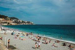NICE, FRANCE - JUNE 26, 2017: People enjoying sunny weather on the beach of Mediterranean sea. Europe, France stock images