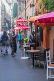 Small narrow street with soldiers in city center of Nice. Nice, France - June 2, 2019: Small narrow street with soldiers in city center of Nice stock photo