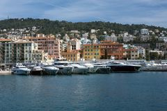 Nice, France, March 2019. Azure sea, yachts, lighthouse. Port and parking of private yachts in Nice. Luxurious comfortable life.  royalty free stock images