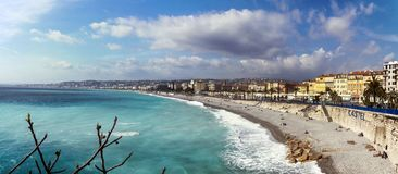 Nice, France, March 2019. Panorama. Azure sea, waves, English promenade and people resting. Rest and relaxation by the sea. On a. Sunny warm day, blue waves stock images