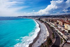 Panorama. Azure sea, waves, English promenade and people resting. Rest and relaxation by the sea. stock photo