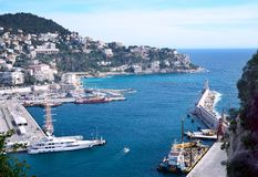 Nice, France, March 2019. Port of the French city of Nice. Private yachts and boats are parked near the coast. Beautiful mountains, the port, the lighthouse stock photography