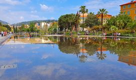 NICE, FRANCE, MAY - 2018: Fountain in Promenade du Paillon park. An architectural complex of buildings in the boulevard. And its reflection in water royalty free stock photos