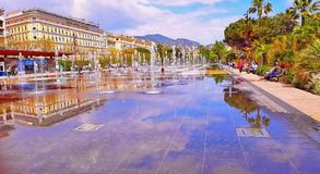NICE, FRANCE, MAY - 2018: Fountain in Promenade du Paillon park. An architectural complex of buildings in the boulevard. And its reflection in water stock photo